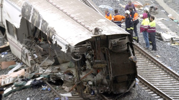 Emergency workers at the derailment scene July 25.