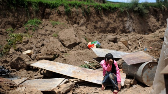 Song Xiaomei cries on Wednesday, July 24, after her home was destroyed by an earthquake in northwest China