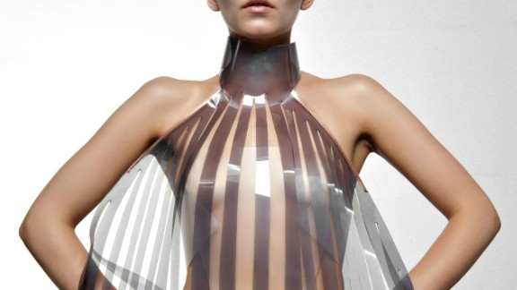 The dress that turns transparent when the wearer is aroused. Would you try it? Dutch design collective Studio Roosegaarde have developed a sensual dress called Intimacy 2.0 together with designer Anouk Wipprecht.  Made of leather and smart e-foils, it 'explores the relationship between technology and intimacy'. The high-tech panels are stimulated by the heartbeat of the wearer. Initially opaque or white, they become increasingly transparent when exposed to an electric current -- in this case a beating heart.