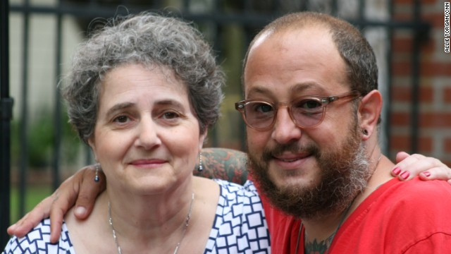 Kevin was raised by his grandparents and is seen here today with his aunt, Sylvie de Toledo.