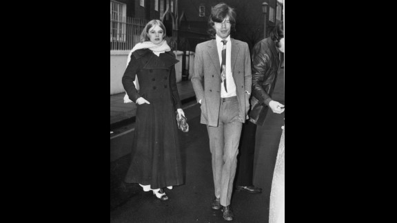 """But it seems the singer had a more simple reason for wearing his pants high and tight, as he did here in 1970 alongside his girlfriend at the time, Marianne Faithfull. """"I've always done a kind of skinny silhouette because I am skinny; I don't have to worry about covering up fat bits!"""" he has previously told <a href=""""http://www.wwd.com/fashion-news/fashion-features/sartorial-satisfaction-6501480?page=1"""" target=""""_blank"""" target=""""_blank"""">Women's Wear Daily</a>. """"So you've got to emphasize your silhouette."""""""