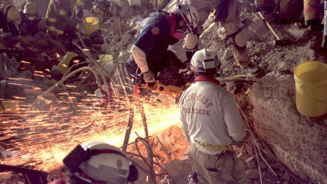 Rescue workers use a saw to cut through debris as the hunt for survivors continues 10 days after the blast.
