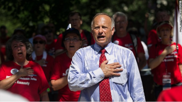 Rep. Steve King, R-Iowa, sings the National Anthem as activists rally against the Senate's immigration legislation.