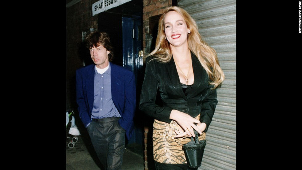 In 1992, Mick Jagger and then-wife Jerry Hall leave the Shaftesbury Theatre in London.