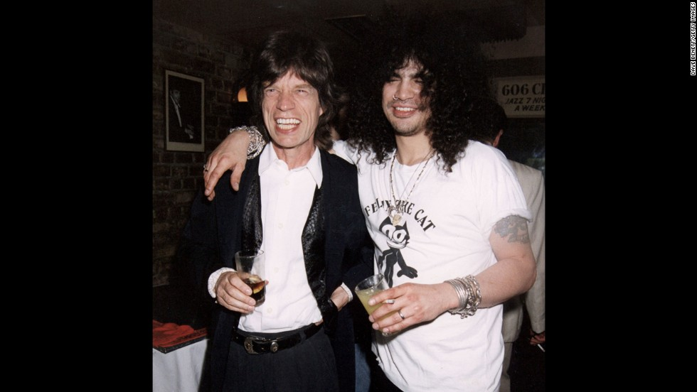 In 1996, Mick Jagger parties with Slash of Guns N' Roses at a club in London.