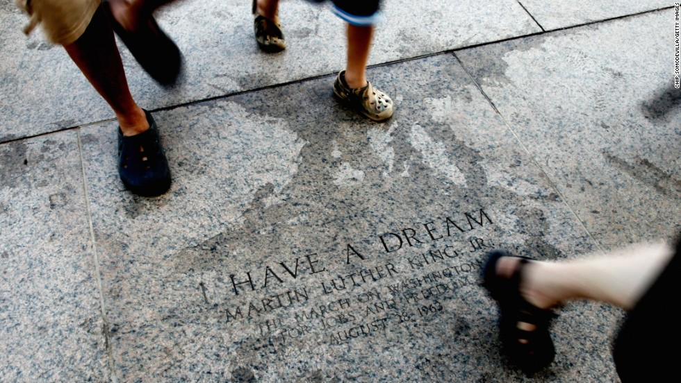 In August 2010, tourists pass the marker commemorating King's 1963 speech on the east steps of the Lincoln Memorial.