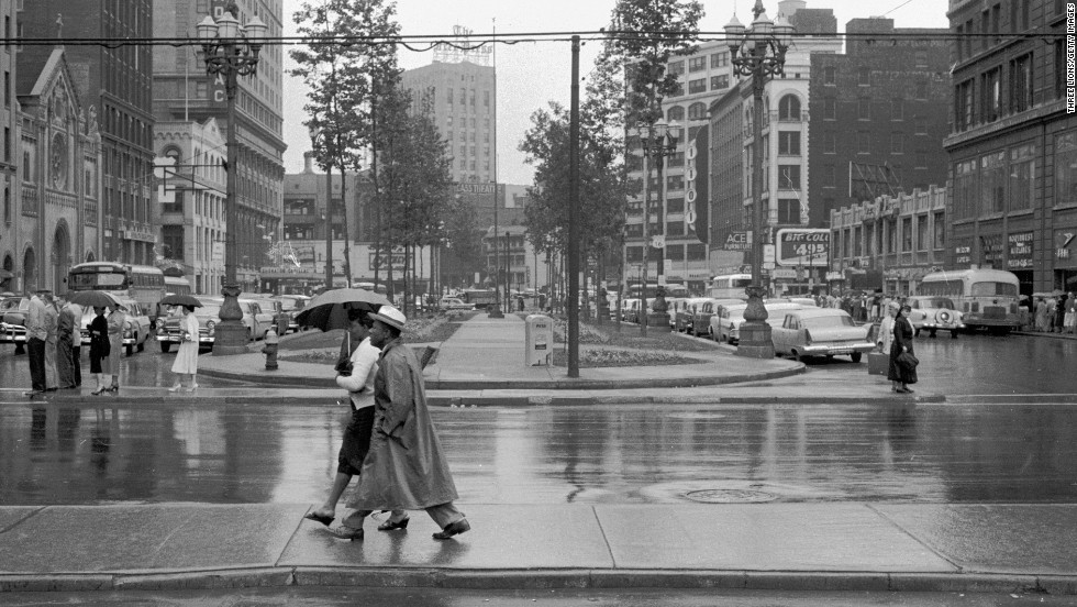 Downtown Detroit is full of people on a rainy afternoon circa 1955. Looking at old photos of the Motor City, Ewing says she always was a bit envious of the city life that eluded her and her siblings who grew up in the suburbs.