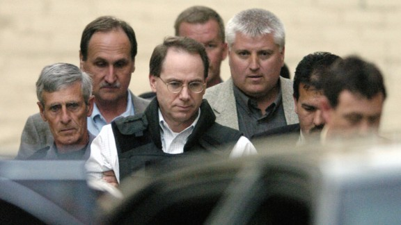 Nichols is escorted out a courthouse in McAlester, Oklahoma, in 2004. He was sentenced to 161 consecutive life terms without the possibility of parole.