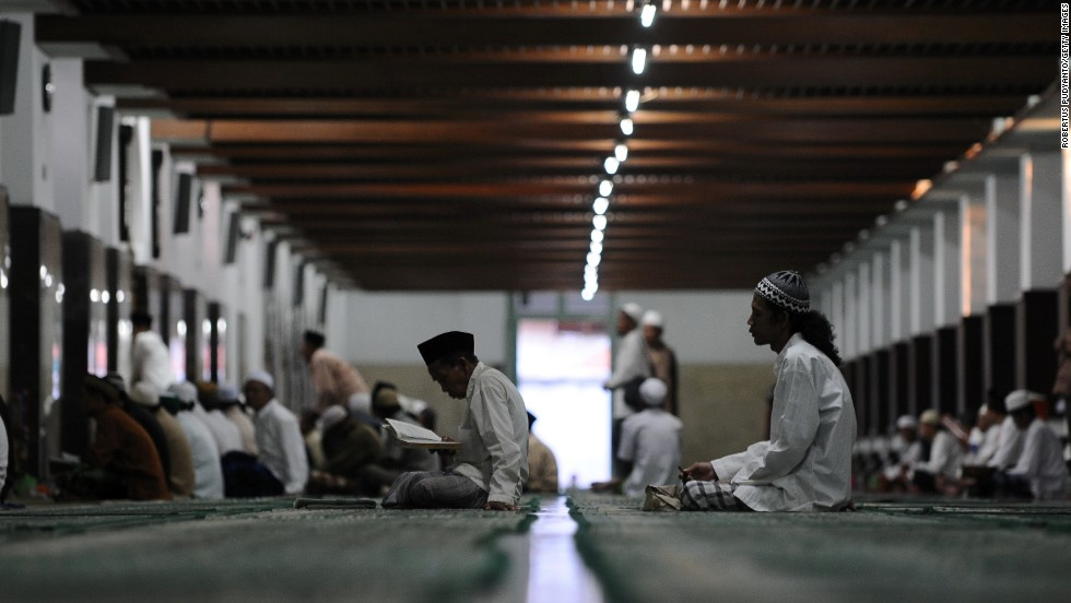 Muslim men pray July 25 at a mosque in Surabaya, Indonesia.