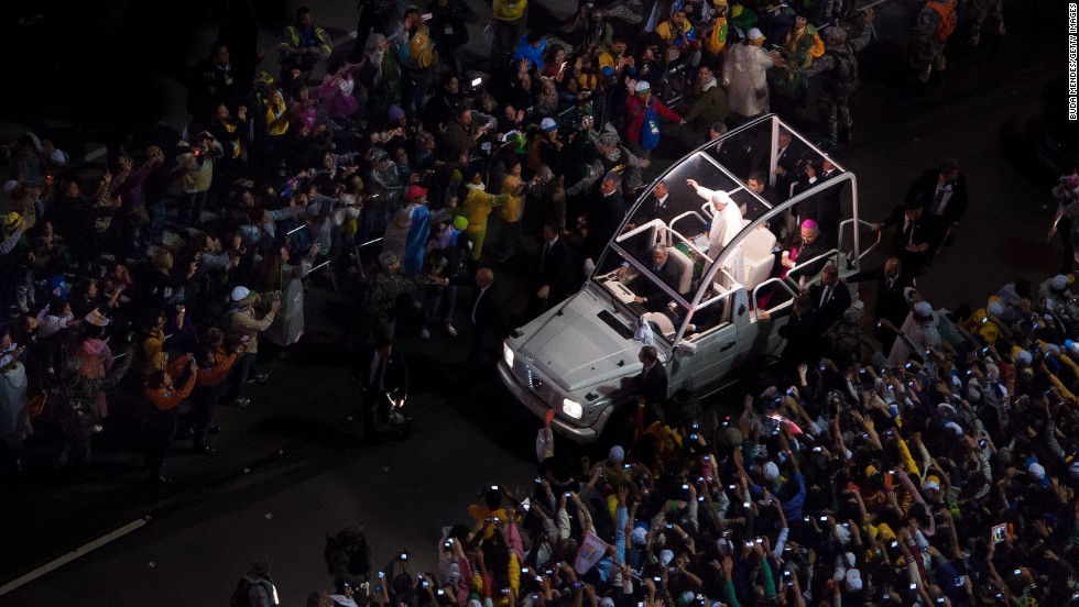 "JULY 26 - RIO DE JANEIRO, BRAZIL: Pope Francis arrives to celebrate Mass at Copacabana beach on July 25. The pontiff addressed <a href=""http://religion.blogs.cnn.com/2013/07/25/in-address-to-youth-in-brazil-pope-francis-speaks-their-language/"">about a million worshippers</a> at World Youth Day celebrations in Rio. His speech came at a time when <a href=""http://cnn.com/2013/06/28/world/americas/brazil-protests-favelas"">millions of Brazilians</a> have expressed discontent with their government."