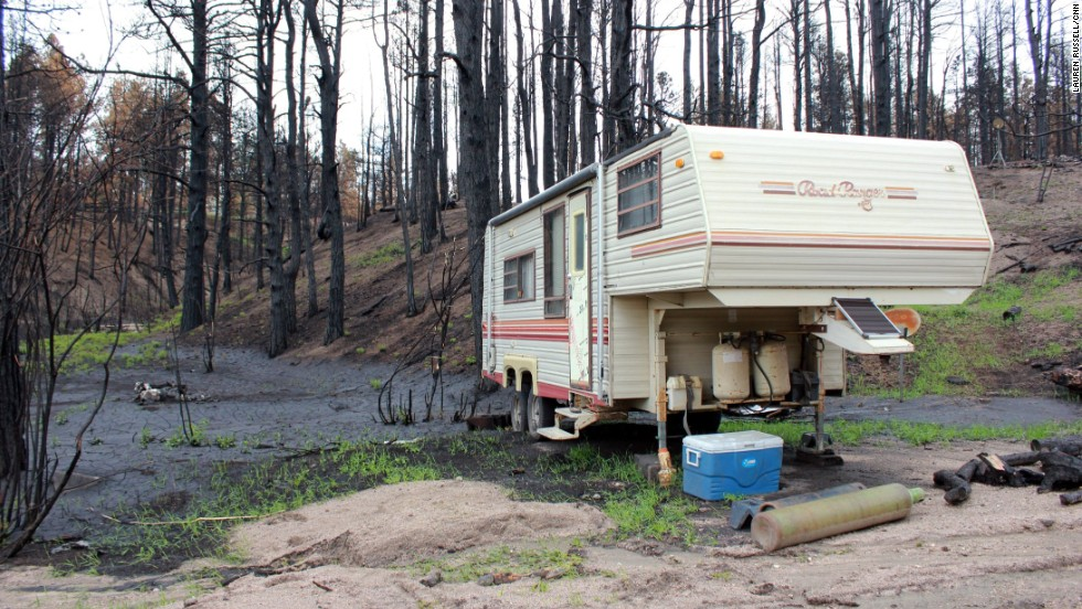 Havens and Andree parked a camper by their pond in hopes of eventually moving back to their property.