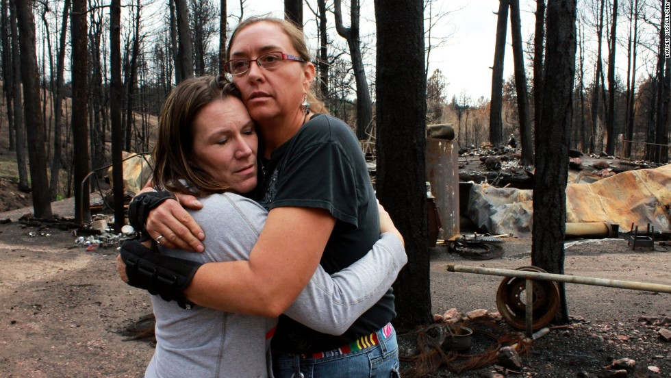 Amanda Davis, left, comforts Michelle Andree on Monday, July 15, after Andree came to see what damage heavy rains had done to her cleanup effort. Davis, whose home survived the fire, founded the nonprofit Crosses for Losses for victims of the June fire that burned through the Black Forest community.