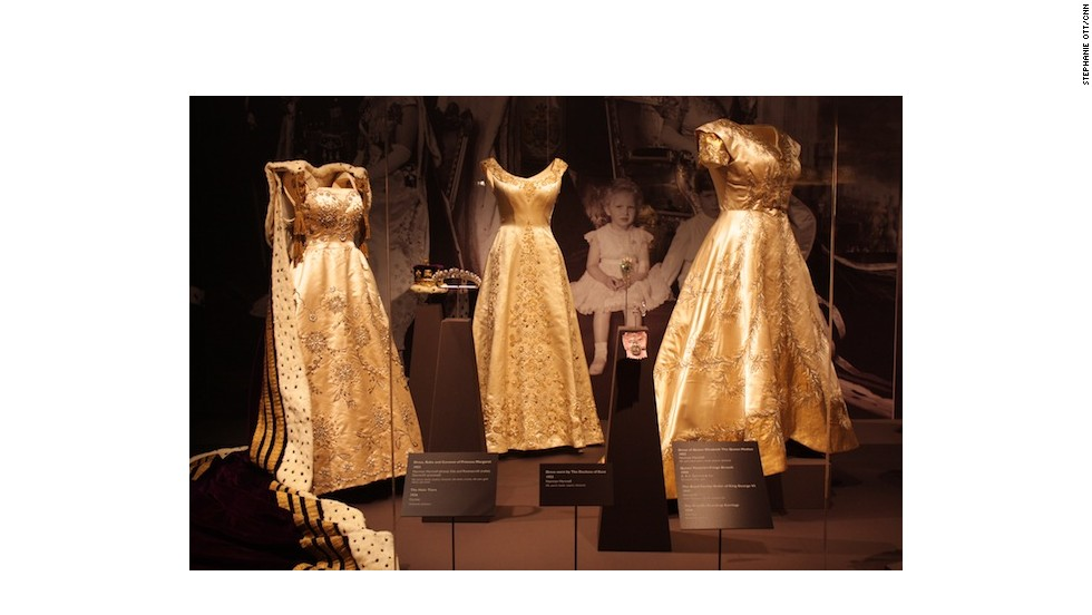 Dress, robe and coronet worn by Princess Margaret, dress worn by the Duchess of Kent, and dress of Queen Elizabeth The Queen Mother (from left to right).