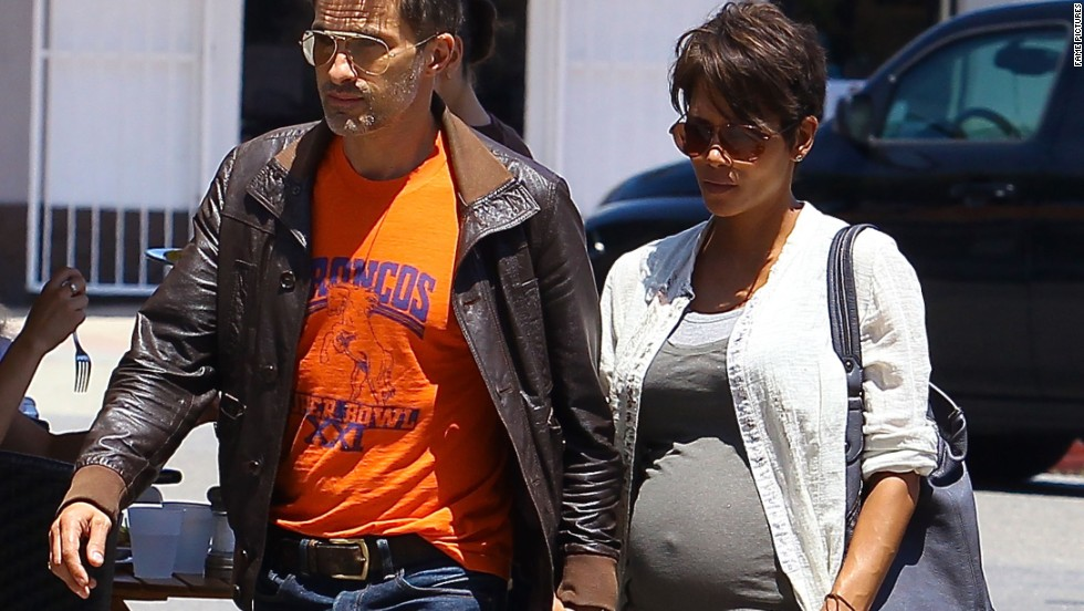 Halle Berry and her new husband Olivier Martinez walk hand-in-hand in Sherman Oaks, California on July 25.
