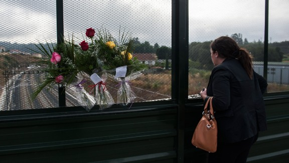 A woman looks over the scene from a bridge on July 26.
