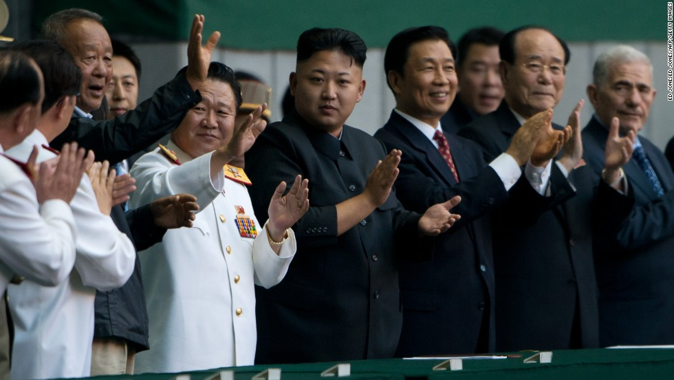 North Korean leader Kim Jong Un, center, applauds before the Arirang Festival at the 150,000-seat Rungrado May Day Stadium in Pyongyang on July 26.
