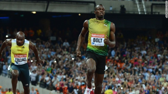 Usain Bolt crosses the line first in the 100m event at the London Anniversary Games in a time of 9.85 seconds.