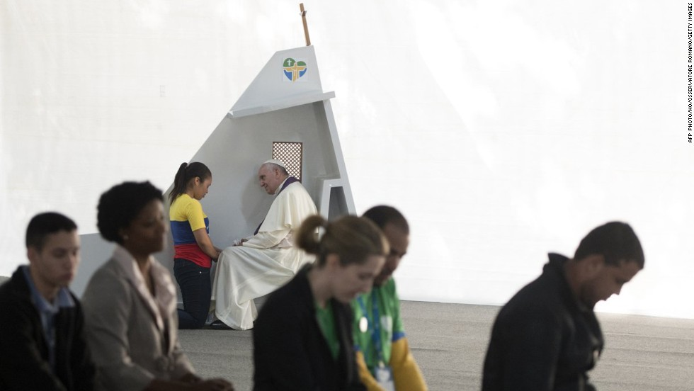 Pope Francis listens to a young woman confess at the Quinta da Boa Vista in Rio de Janeiro, Brazil, on Friday, July 26.