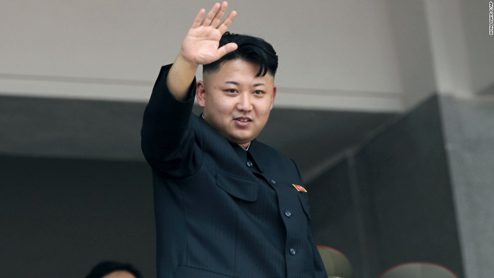North Korea's leader Kim Jong Un waves to spectators and participants during a military parade on July 27, in Pyongang.