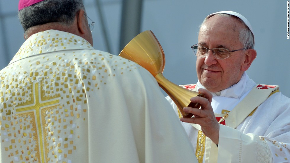 Pope Francis gives a chalice to Rio de Janeiro's Archbishop Orani Joao Tempesta during a Mass on Copacabana Beach on Sunday, July 28. The pontiff has been in the South American country for World Youth Day, a weeklong celebration aimed at revitalizing young Catholics.