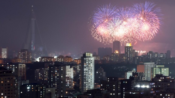 Fireworks explode above the Pyongyang skyline on Saturday, July 27. North Korea mounted its largest military parade to mark the 60th anniversary of the armistice that ended fighting in the Korean War, displaying its long-range missiles at a ceremony presided over by leader Kim Jong Un.