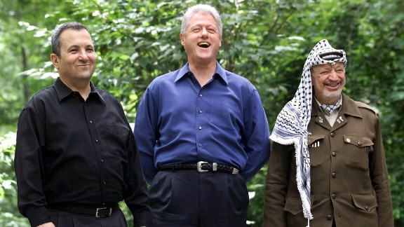 Then-Israeli Prime Minister Ehud Barak, left, with the then-President Bill Clinton and Palestinian leader Yasser Arafat pose for a photograph on July 21, 2000, at Camp David, in Maryland. The Camp David Summit was an effort to resolve the issues of the 52-year-old Israeli-Palestinian conflict including the status of Jerusalem, the borders and nature of a Palestinian state, and the future of Jewish settlers and Palestinian refugees. The Summit ended without an agreement.