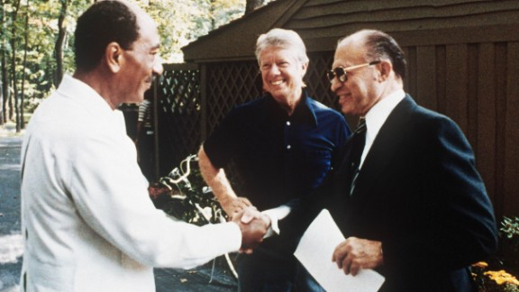 Then-Egyptian President Anwar Sadat, left, shakes hands with then-Israeli Prime Minister Menachem Begin, in the garden of Camp David on September 6, 1978. With the help of then-President Jimmy Carter, the Camp David Accords became the groundbreaking first-ever peace treaty between Israel and Egypt.