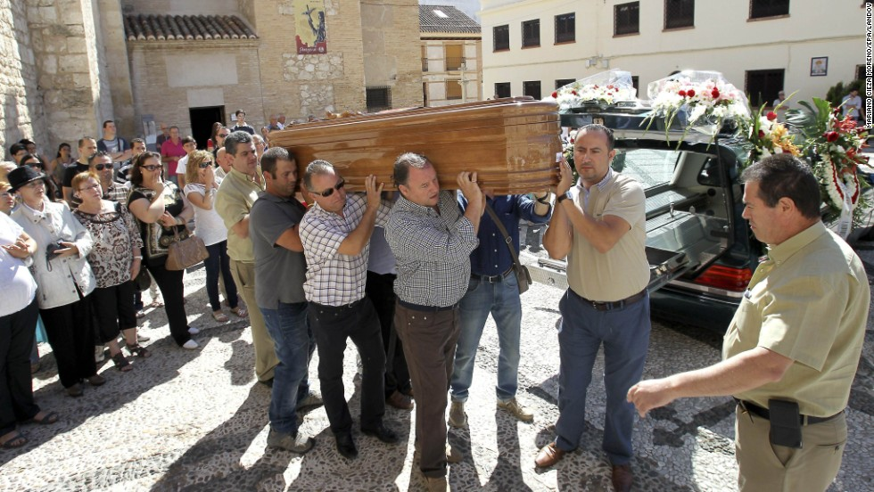 People carry the coffin of a victim in Ciudad Real, Spain, on July 29.