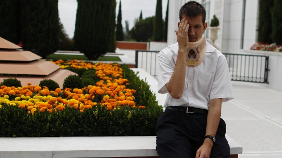 Eighteen-year-old Stephen Ward rests outside a church in Madrid on Saturday, July 27. Ward, from Utah, was among the survivors of the deadly train crash.