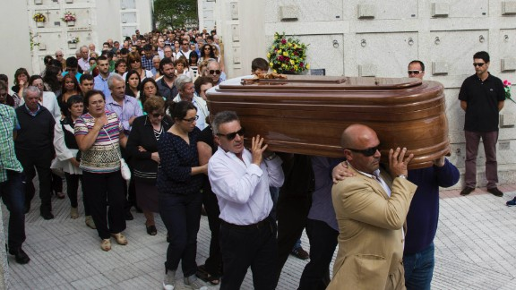 People carry the coffin of a victim at the San Pedro de Visma cemetery in A Coruna, Spain, on July 27.