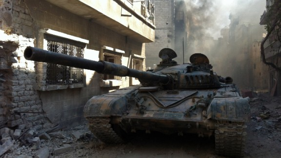 A government  tank is shown in the Khalidiya neighborhood of Syria