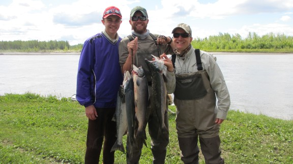 The author, far right, proudly displays a morning's catch on Alaska's Yentna River with his sons Charlie, left, and John.