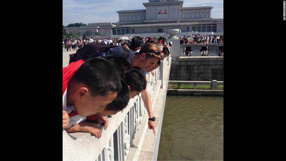 "Elsewhere, Watson enjoys a contemplative moment with North Korean schoolchildren enjoying the carp pools by the<a href=""http://instagram.com/p/cLfanRhqJS/ "" target=""_blank""> Kumsusan Palace of the Sun</a>. ""[It was a] fascinating and strange experience,"" Watson reflected of his time in the country."
