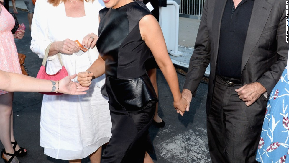 Sarah Michelle Gellar and Robin Williams hold hands as they move through the crowd gathered at the CW, CBS and Showtime summer TCA party on July 29.