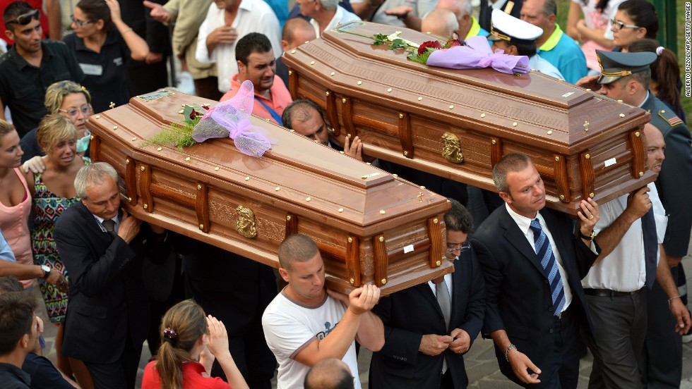 Coffins get carried out of the morgue in Monteforte Irpino on July 29.