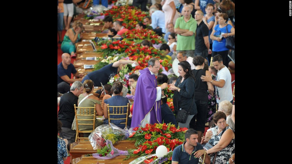 An estimated 5,000 people turned out for the Pozzuoli funeral, held in a sports arena, a police official says.