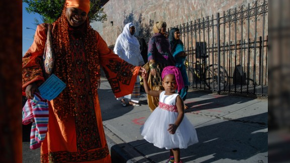 """""""There are four mosques in the immediate neighborhood and each one celebrates Eid slightly differently,"""" said Stephanie Keith from Bedford-Stuyvesant, a part of Brooklyn that has become a popular area for African immigrants. """"One mosque has the street blocked off during prayer time and all the worshippers fill the streets. Another mosque blocks off the street for the whole day and has a street party. But at every mosque, people don their fanciest outfit of the year most in an African style,"""" said the 47-year-old travel journalist who used to live and work in Egypt."""