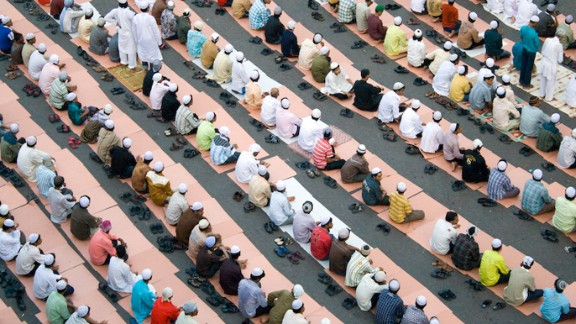 """Anupama Kinagi, 37, shot this photo of Muslims in prayer from a terrace near the Hamidiya Masjid mosque in Mumbai, India. He said he wanted to capture the geometric pattern formed by so many bowed heads and bodies: """"It was a beautiful morning. The sky was clear. There were hundreds of men gathered to prayer as a ritual. The men were dressed in Kurta Pajama. The place was noisy but as soon as the prayers started it was so peaceful and pin drop silence. After the prayers everyone hugged and greeted each other"""