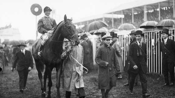 Britain's royals have strong links to racing. A horse owned by King George V is escorted home after winning the Steward's Cup at Royal Ascot in 1911.