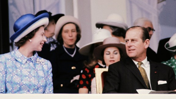 Queen Elizabeth II and her husband the Duke of Edinburgh enjoy the racing at Longchamps in Paris in 1972.