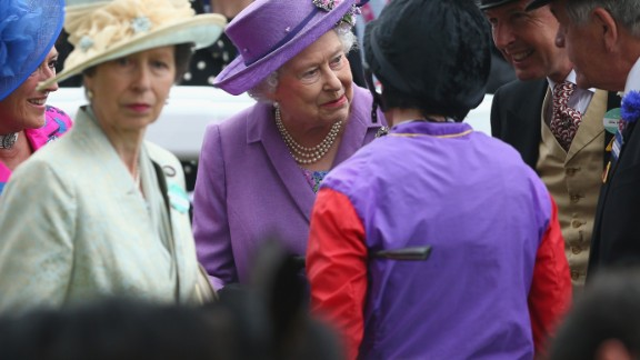 Britain's monarch shares a private moment with her connections and jockey Ryan Moore after the historic victory in June 2013. Her only daughter Princess Anne, who represented Britain at the 1976 Olympics in equestrian, is to her left.