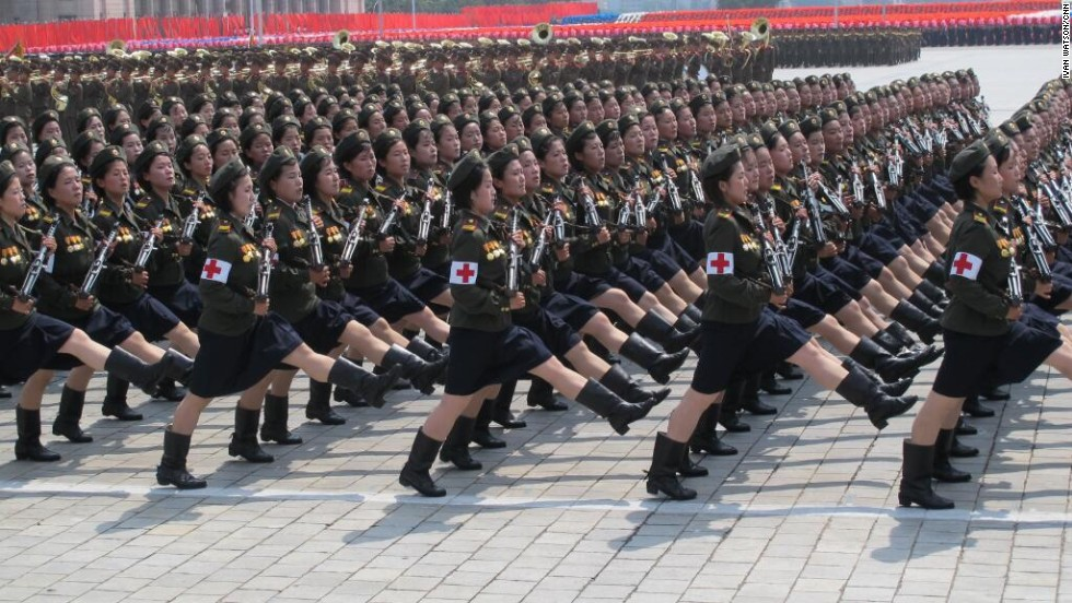 "Nurses with guns goose-step through Kim Il Sung Square in Pyongyang, North Korea, during a mass military parade on Saturday, July 27.  The parade was part of elaborate celebrations for the 60th anniversary of the end of the Korean War-- known in the country as ""Victory Day.""  CNN's Ivan Watson was part of a Western media contingent allowed into North Korea to cover the occasion."
