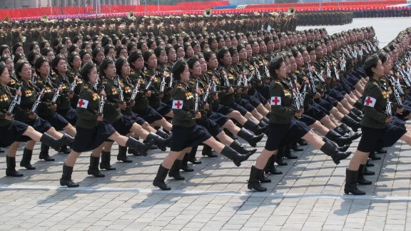 """Nurses with guns goose-step through Kim Il Sung Square in Pyongyang, North Korea, during a mass military parade on Saturday, July 27.  The parade was part of elaborate celebrations for the 60th anniversary of the end of the Korean War-- known in the country as """"Victory Day.""""  CNN"""