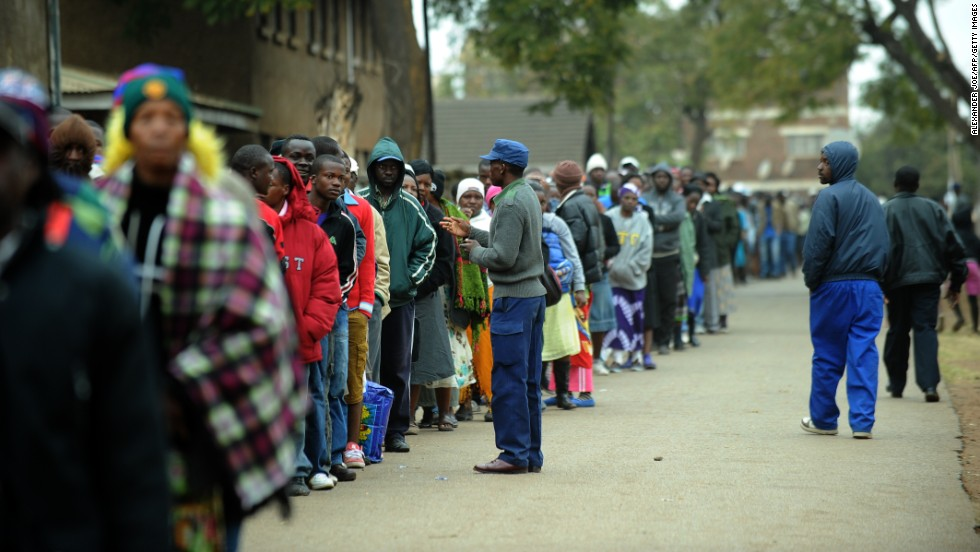 "Zimbabweans line up near a polling station in Harare to <a href=""http://cnn.com/2013/07/31/world/africa/zimbabwe-election/index.html?hpt=hp_t1"">vote in a general election</a> on July 31, 2013 as President Robert Mugabe seeks to extend power to a potential 38 years."