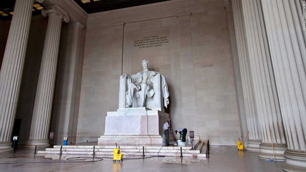 National Park Service workers clean the Lincoln Memorial in Washington on Friday, July 26, after someone splattered green paint on the statue of Abraham Lincoln and on the floor. A woman was arrested Monday, July in connection with vandalism on two locations inside the National Cathedral. Jiamei Tian, 58, was not immediately tied to the vandalism of the Lincoln Memorial or other incidents that occurred over the past week.