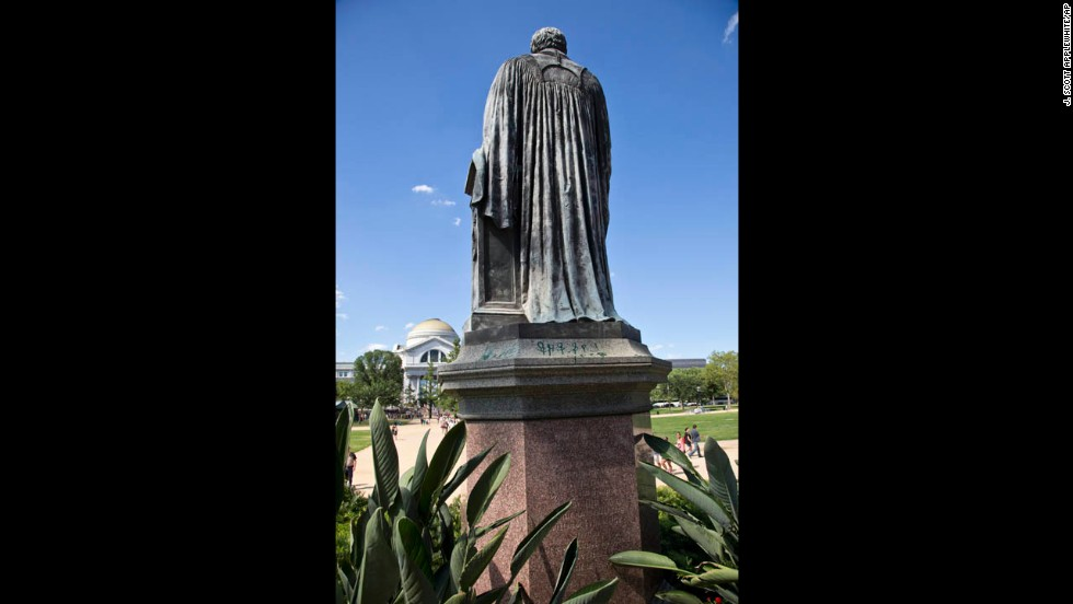 Green paint was tossed on the pedestal of the statue of Joseph Henry outside the headquarters of the Smithsonian Institution in Washington on Monday, July 29.