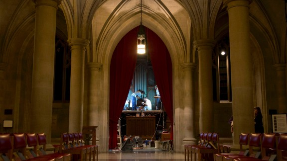 Members of Gold Leaf Studios, an art preservation organization, work to remove green paint from the organ in the Washington National Cathedral's historic Bethlehem Chapel on Tuesday, July 30.