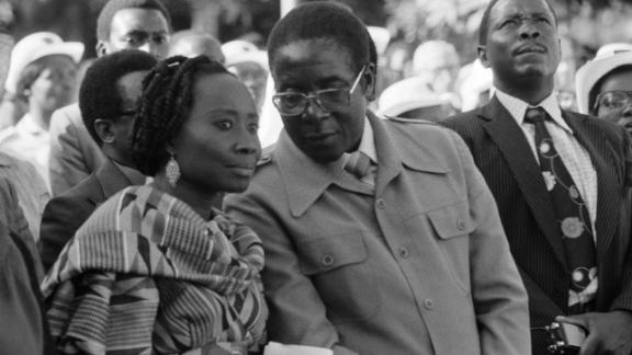 Mugabe speaks with his first wife, Sally, during an event in Salisbury in 1980. The pair were married until Sally died in 1992. They had one son, who died at age 4.