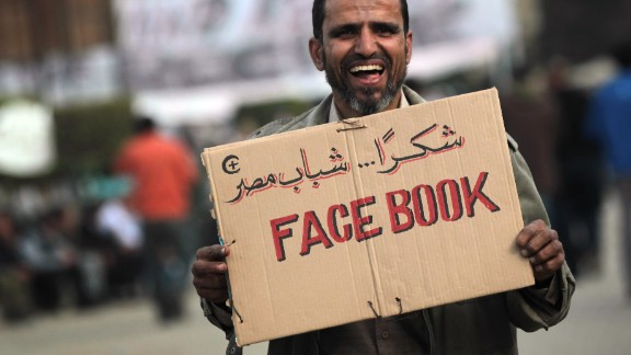 CAIRO, EGYPT - FEBRUARY 03: An anti-government demonstrator holds a sign during clashes on February 3, 2011 in Cairo, Egypt. Initial protests against the government were organized on internet social media. The Egyptian army positioned tanks between the protesters during a second day of violent skirmishes in and around Tahrir Square in Cairo.