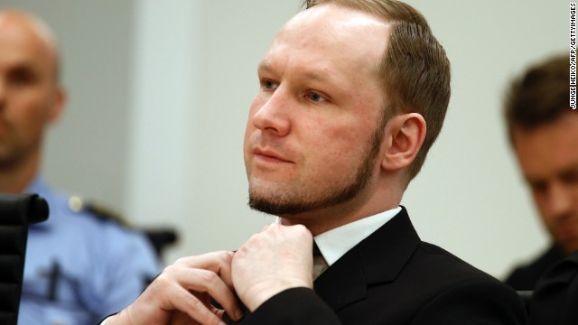 (File) Self confessed mass murderer Anders Behring Breivik stands in Oslo District Court on August 24, 2012.